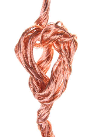 Twisted copper wire isolated on white background  photo