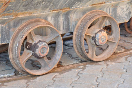Raw of wheels of old mine carts photo