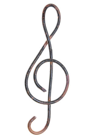copper wire: Old copper wire in shape of G-clef on a white background