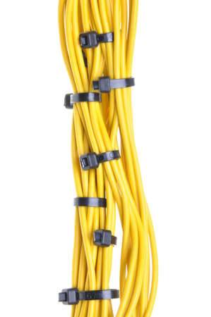 Bundle of yellow cables with white cable ties photo