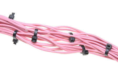 Bundle of pink cables with white cable ties photo