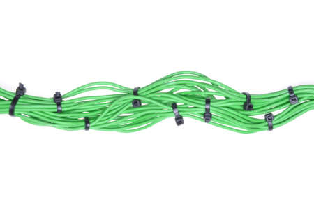Bundle of green cables with black cable ties photo