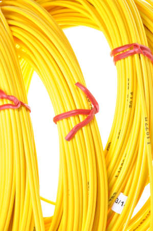 Yellow fiber optic cables isolated on white background photo