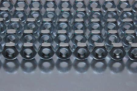 regular: Nuts on sheet surface in regular pattern