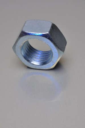 Single nut with blue light reflection photo