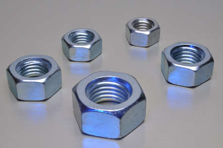 Steel nuts on metal surface photo