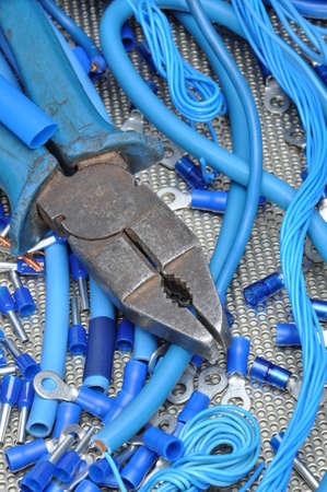 electrical component: Pliers with electrical component kit for use in electrical installations Stock Photo