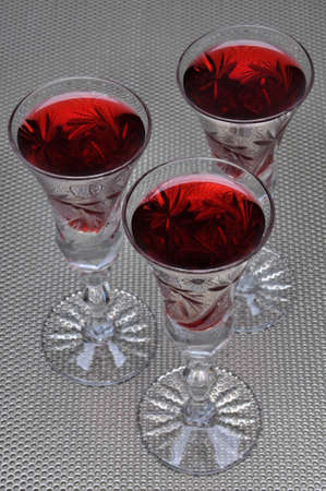 metal surface: Alcoholic liquors in the crystal glasses on metal surface