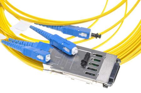 fiber cable: Gigabit Interface Converter met glasvezel kabel op witte achtergrond Stockfoto