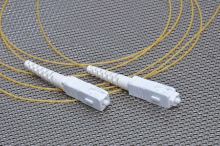 fiberoptic: Fiber optical cable patch cord on metal surface