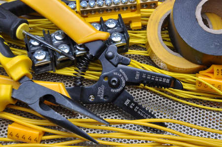 electrical contractor: Pliers strippers with electrical component kit Stock Photo