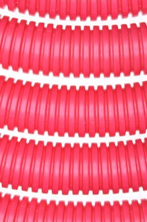 plastic conduit: Red plastic corrugated pipe on white background