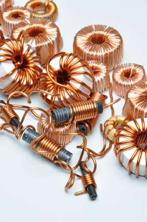 electromagnetism: Electrical coils on metal background