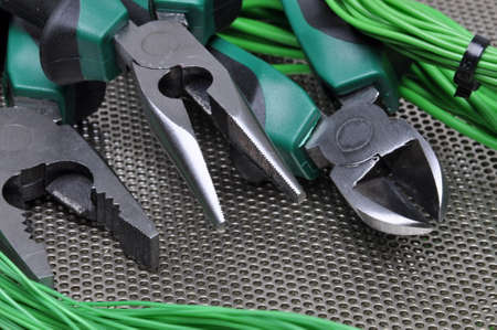 metal surface: Electrical tools and cables on metal surface