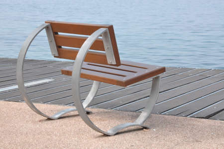 empty bench: Empty bench on the lakeshore of Lake Garda, Bardolino, Italy Stock Photo