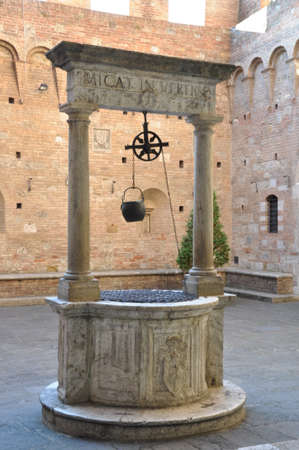 water well: Old stone water well in Tuscany, Italy Stock Photo