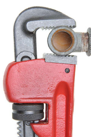 plumb: Red plumbers pipe wrench and plumbing component isolated on white background