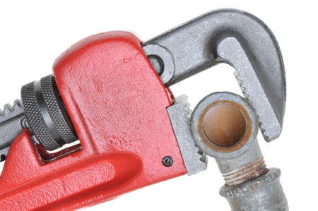 hard component: Red plumbers pipe wrench and plumbing component isolated on white background