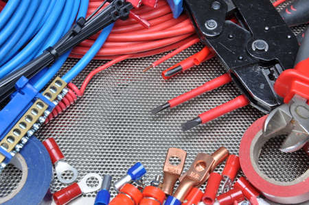 electric wires: Electrical tools, component and cables on metal surface