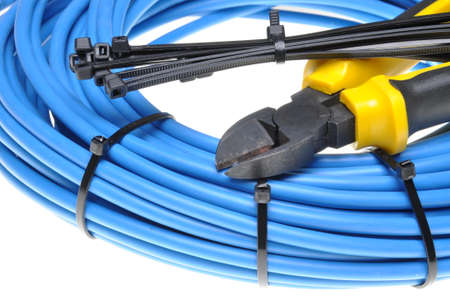 electrical contractor: Pliers with electrical cables and cable ties Stock Photo