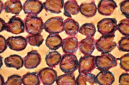 fruitcake: Freshly baked plum cake, top view