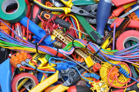 colorful: Tools and electrical component kit used in electrical installations Stock Photo