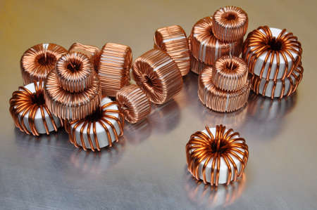 coils: Electric copper coils on metal background