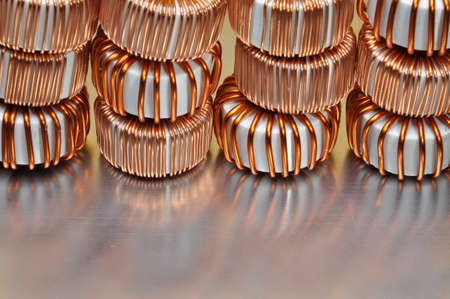 electromagnetism: Electric copper coils on metal background