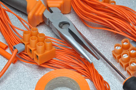 electrical contractor: Tools and electrical component kit to use in electrical installations Stock Photo