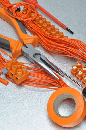 component: Tools and electrical component kit to use in electrical installations Stock Photo