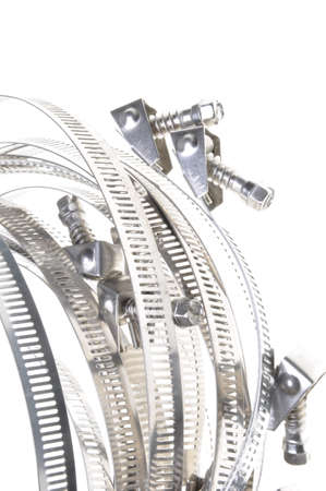clamps: Metal hose clamps on isolated white background Stock Photo