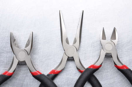 wire cutter: Electrical tools wire cutter, pliers on metal gray surface Stock Photo
