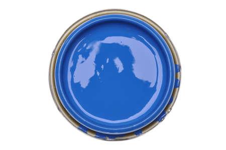 Kan deksel met blauwe verf op een witte achtergrond, bovenaanzicht Stockfoto