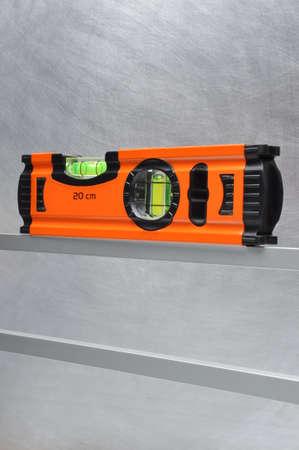 spirit level: Construction tool spirit level on line of metal profiles