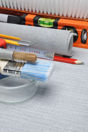 redecoration: Tools used for wallpapering, renovation and repair at home Stock Photo