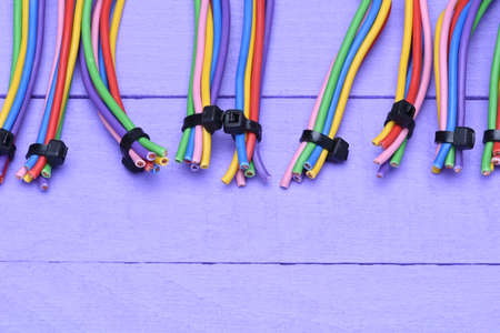 multicore: Colored cables on wooden background