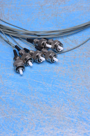 fiber optic cable: Fiber optic cable pigtails on blue background