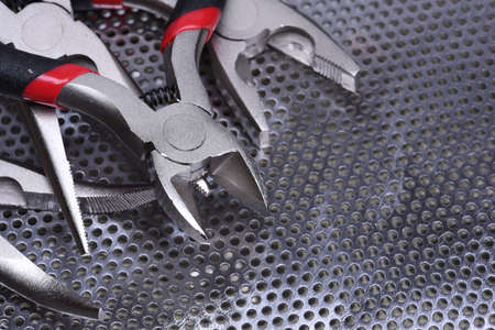 wire cutter: Electrical tools wire cutter, pliers on metal background Stock Photo