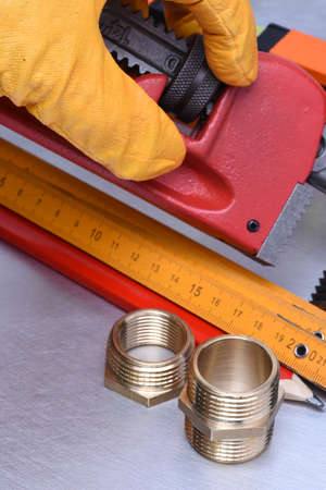 close fitting: Hand in glove holds plumbing parts