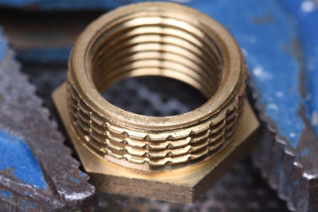 threaded: Closeup of brass threaded connector nipple with wrench