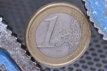 budget restrictions: Concept of financial crisis in Europe, wrench with a one euro coin Stock Photo