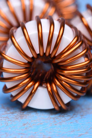 impedance: Macro of a copper coils on blue background