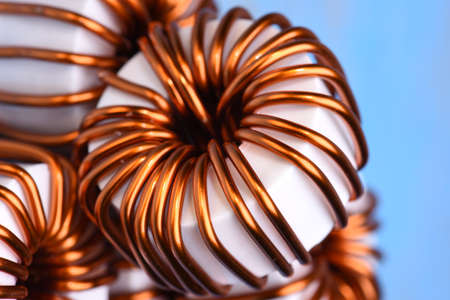 Macro of a copper coils on blue background