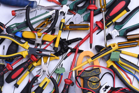 cable cutter: Tools to use in electrical installations on wooden background Stock Photo