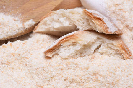 breading: Pieces of bread on the background of bread crumbs Stock Photo