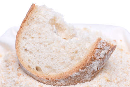 Homemade breadcrumb with slice of bread isolated on white background