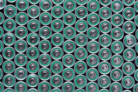 alkaline: Group of alkaline batteries as background Stock Photo