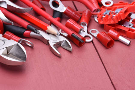 putty knives: Tools and accessories to use in electrical installations on wooden background Stock Photo