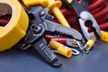 Tools and cables for electrician Stockfoto