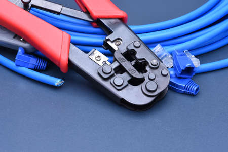 crimping: Crimping tool with cable for computer network